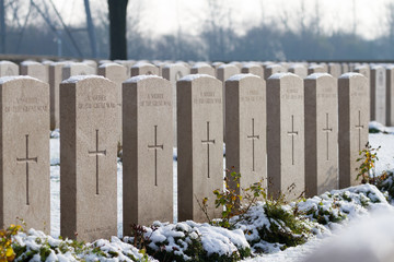Snow covering the graves of unknown soldiers at the Commonwealth War Graves Commissions (CWGC) Brown's Copse Cemetery in Northen France.