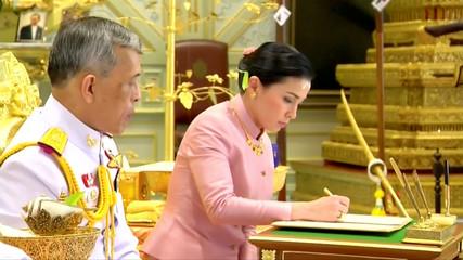 King Maha Vajiralongkorn and his consort, General Suthida Vajiralongkorn named Queen Suthida sign marriage documents during their wedding ceremony in Bangkok