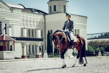 Good looking young man riding a beautiful horse Wall mural