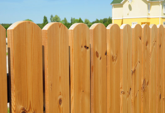Wooden fence detail construction, Wooden house fencing. Close up on cozy wooden fence