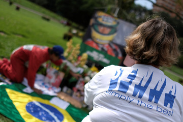 Fan takes a picture of the grave of Brazil's Formula One driver Ayrton Senna, on the 25th anniversary of his death, in Sao Paulo