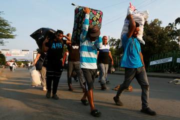 People cross the border between Colombian and Venezuelan over the Simon Bolivar international bridge in Cucuta