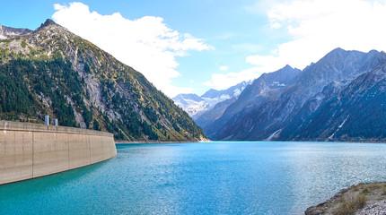 """Dam with big lake in austrian Alps / Reservoir """"Schlegeis"""" in a Valley in Austria"""
