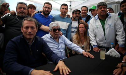 Hugo Moyano, president of the soccer team Club Atletico Independiente poses for a picture next to his son, Pablo Moyano, head of the Truckers' union, during a May Day protest against Argentina's President Mauricio Macri's policy, in Buenos Aires