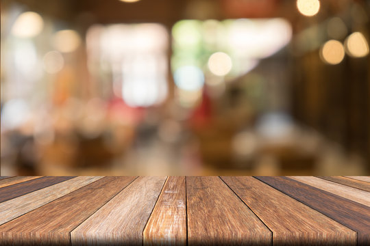Empty wooden table of brwon in front Warm orange color of bokeh on wooden background