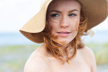 portrait of young woman in straw hat