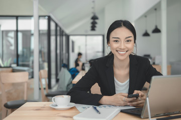 Successful business woman working on laptop computer.Typing laptop keyboard on working...