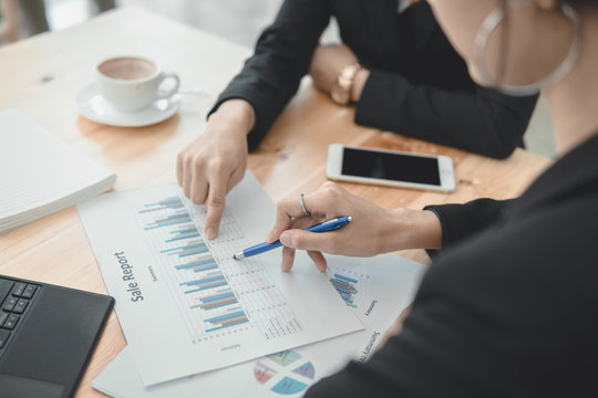 Teamwork business with Financial report together decide for successful business.Maketing plans and strategy investment report concept.