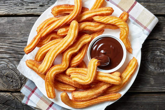 close-up of churros on plate with chocolate sauce