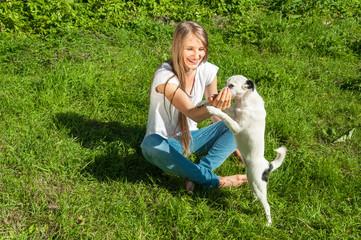 Beautiful girl playing with dog