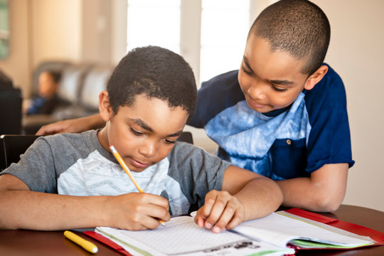 two black brother child doing homework at home