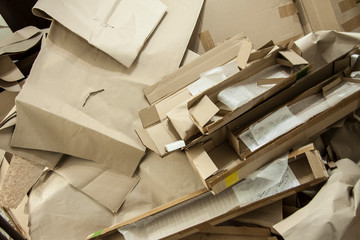 Various cardboard boxes. Waste production. Paper packaging. Recycling paper. Ecology and environment protection. Background image.