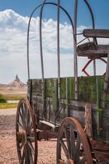 Wooden wagon and Chimney Rock, Nebraska, United States