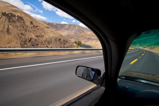 Car driving on road through Yakima River Canyon, Washington, United States