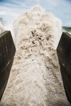 Water crashing through spout