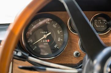 Close up of speedometer in retro Ferrari dashboard