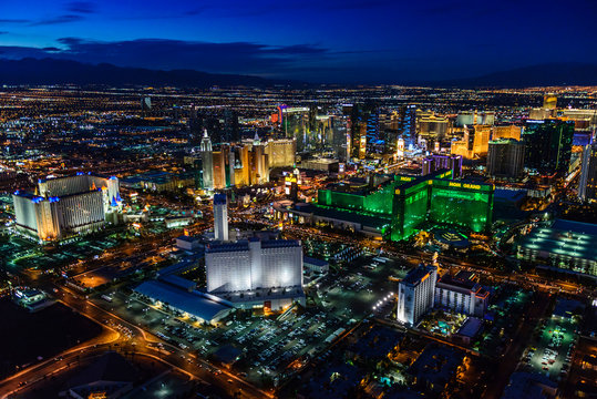 Aerial view of Las Vegas cityscape lit up at night, Las Vegas, Nevada, United States