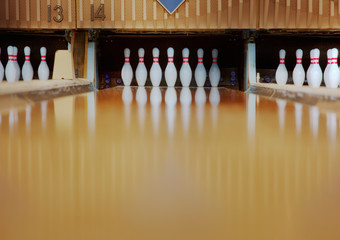 Bowling pins reflecting in bowling alley lane
