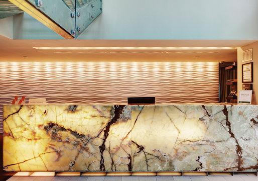 Marble reception desk in hotel lobby