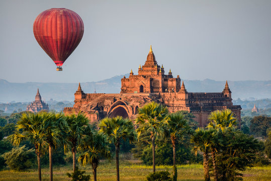 Hot air balloon flying over temple