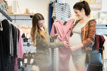 Caucasian pregnant woman shopping with friend