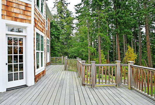 Wooden deck on house near forest
