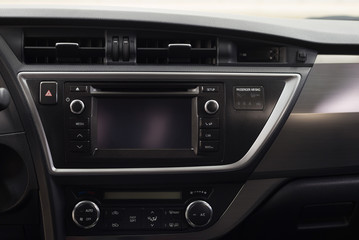 Modern car dashboard with multimedia screen. Interior detail.