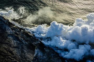 Smoke from lava near ocean