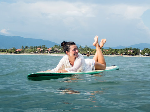 Portrait of a woman on her surfboard