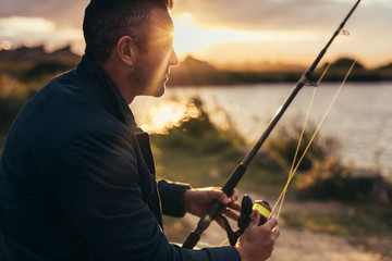 Man fishing near a lake