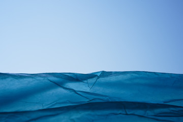 Blue package. Abstract image of mountains of plastic bags. Drawing attention to the topic of environmental pollution.