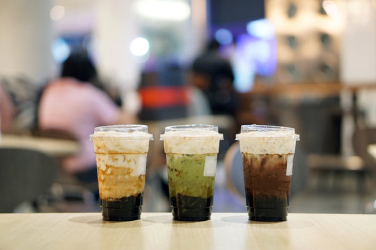 Set of summer drinks, Glass of fresh milk tea, matcha green tea latte and iced dark chocolate, served with black sugar syrup and hot black pearl (Boba) topped with cream cheese, Taiwanese style.
