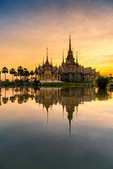 A beautiful sunset view of temple in reflection in twilight  , Nakorn ratchasrima , Thailand