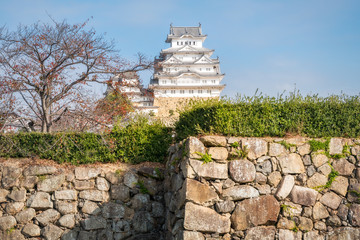 Himeji Castle is an iconic 17-th century Japanese castle known for a white facade, plus towers, moats and cherry trees. It was never conquered due to its strategic design and fortifications.