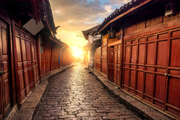 Sunrise landscape view of Lijiang Old yown with local historical architectures building in sunrise scene
