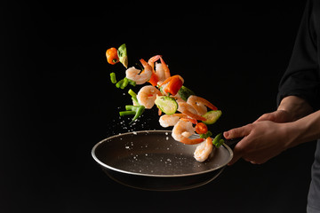 Foto op Aluminium Eten Seafood, Professional cook prepares shrimps with sprigg beans. Frost in the air, Cooking seafood, healthy vegetarian food