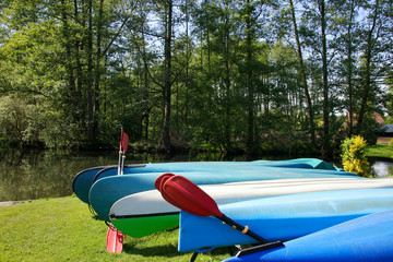 Kayaks and canoes in the Spree Forest (Spreewald), Germany