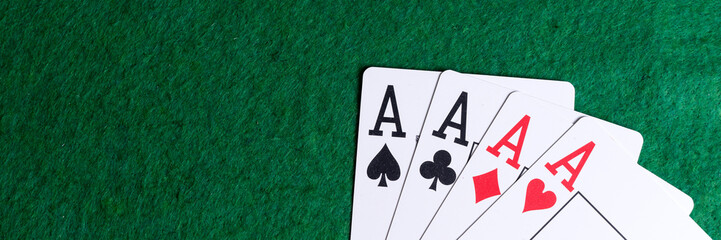 Set of four aces on the green table