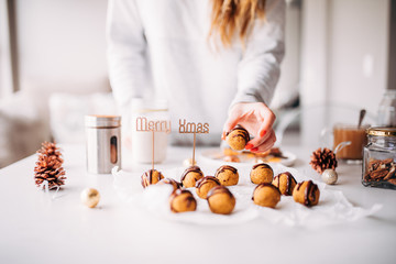 woman doing selfmade biscuits for christmas time