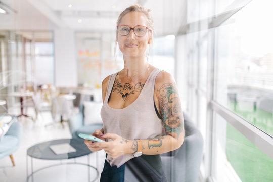 portrait of tattooed business woman