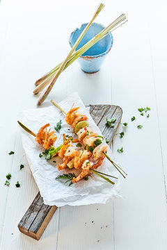 Gourmet grilled prawn tails on bamboo skewers