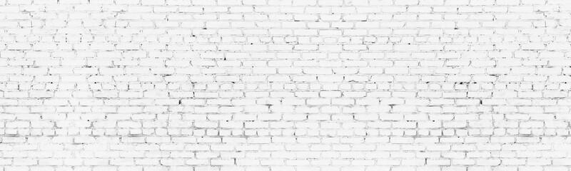 Whitewashed old brick wall wide background. White washed brickwork panoramic backdrop
