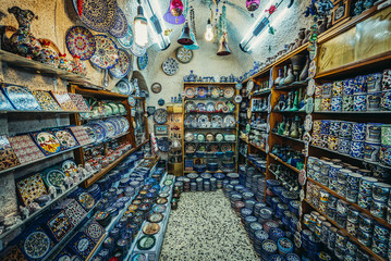 Ceramic plates and other souvenirs for sale on Arab baazar located inside the walls of the Old City of Jerusalem, Israel