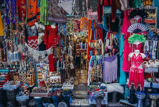 Clothes, scarfs and souvenirs for sale on Arab baazar located inside the walls of the Old City of Jerusalem, Israel