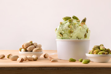 Pistachios ice cream cup decorated with pistachio chunks
