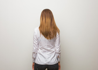 Young russian girl from behind, looking back