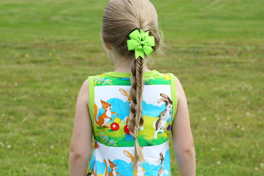 A little girl with a fishtail braid hairstyle