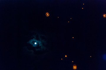 Lanterns at the night sky with full moon