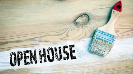 Open House. paintbrush with white color on a wooden background