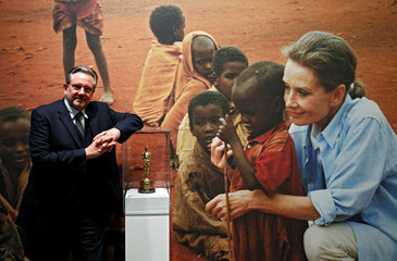 """Audrey Hepburn's son, Sean Hepburn Ferrer poses in front of a picture of his mother at the exhibition """"Intimate Audrey"""" in Brussels"""